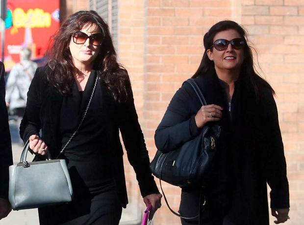 Michelle Morrison (left) with her sister Laura at the High Court