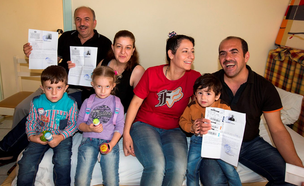 A happy Syrian family after they picked up their permits to continue their journey into mainland Europe Photo: Mark Condren