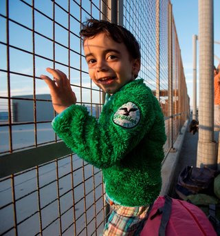 A young Syrian migrant waiting for a ferry to mainland Europe from Kos Photos: Mark Condren