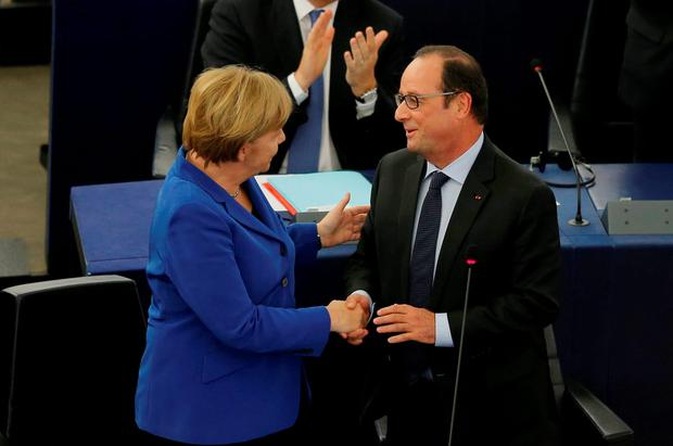 German Chancellor Angela Merkel (L) shakes hands with French President Francois Hollande (R) after addressing the European Parliament in Strasbourg. Photo: Reuters