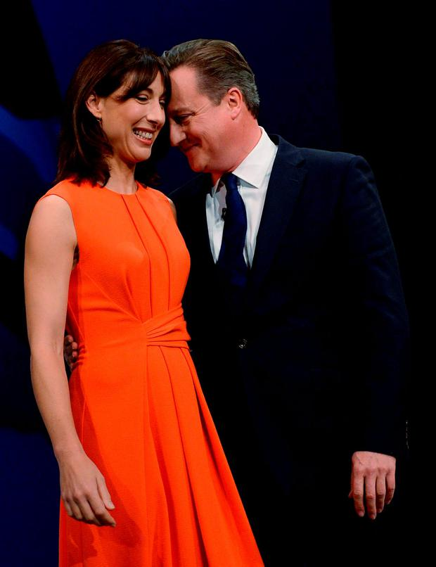 David Cameron stands with his wife Samantha after his address to the Conservative Party conference at in Manchester. Photo: Reuters