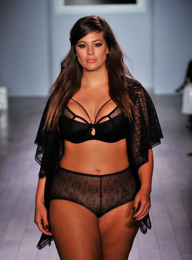 66de0d4a3ba Model designer Ashley Graham walks down the runway during the Addition Elle Ashley  Graham