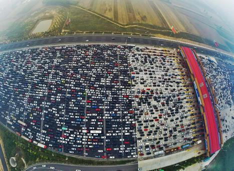 Vehicles are seen stuck in a traffic jam near a toll station as people return home at the end of a week-long national day holiday Credit: China Daily (Reuters)