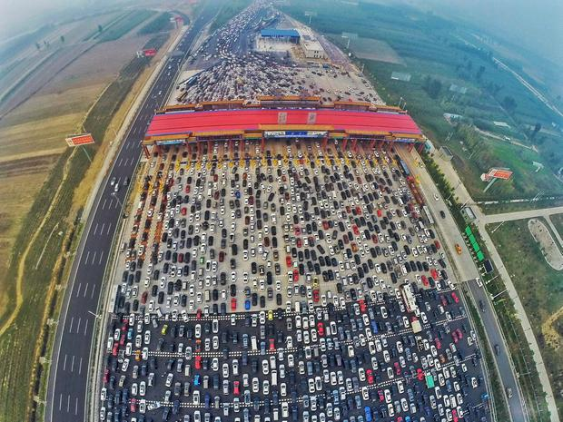 Drivers abandoned their cars in droves after thousands were left stranded Credit: China Daily (Reuters)
