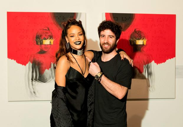 Singer Rihanna (L) and artist Roy Nachum at Rihanna's 8th album artwork reveal for