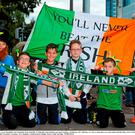 8 October 2015; Aaron Mansfield, Luke Mansfield, Fionn Mulvihill, TJ Mulvihill, Jamie Sheehan and Jamie Maloney, of Killarney AFC, Killarney, Co. Kerry, make their way to the match with their flag. UEFA EURO 2016 Championship Qualifier, Group D, Republic of Ireland v Germany. Aviva Stadium, Lansdowne Road, Dublin. Picture credit: Seb Daly / SPORTSFILE