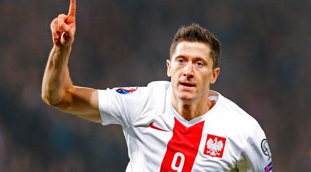 Poland's Robert Lewandowski celebrates scoring their first goal