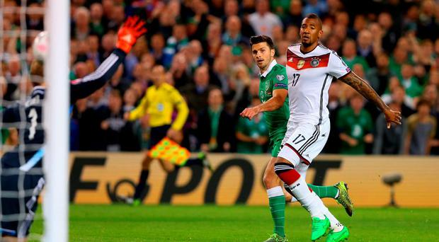 Shane Long of Republic of Ireland scores the opening goal under pressure from Jerome Boateng