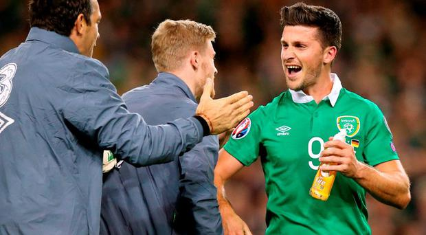 Republic of Ireland's Shane Long (right) celebrates at the final whistle