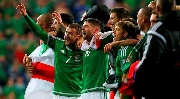 Northern Ireland's Oliver Norwood (centre) and teammates celebrate after the final whistle