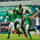 Steve Davis (L) of Northern Ireland celebrates after scoring