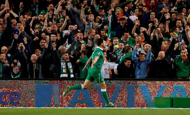 Shane Long celebrates after scoring the first goal for Republic of Ireland