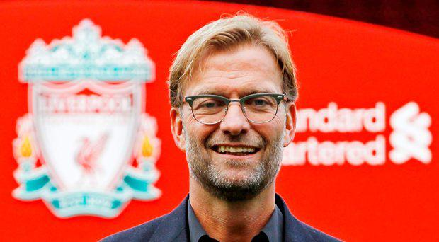 New Liverpool manager Jurgen Klopp poses after the press conference