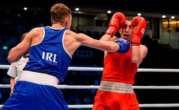 9 October 2015; Sean McComb, left, Ireland, exchanges punches with Albert Selimov, Azerbaijan, during their Men's Lightweight 60kg last 16 bout. AIBA World Boxing Championships, Ali Bin Hamad Al Attiyah Arena, Doha, Qatar. Picture credit: Paul Mohan / SPORTSFILE