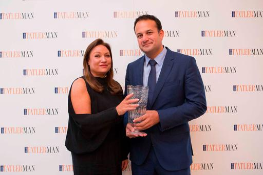 Norah Casey presents Health Minister Leo Varadkar with his award after he was named 'Man of the Year' by Irish Tatler Man Pic: Richie Stokes