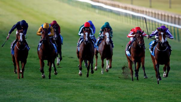 Minding, with Ryan Moore up (right), on the way to winning The Dubai Filies' Mile at Newmarket yesterday