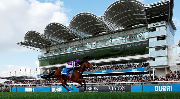 Minding, with Ryan Moore up, wins The Dubai Filies' Mile at Newmarket