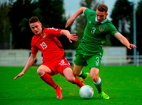 Jack Connors, Republic of Ireland, in action against Sigitas Urbys, Lithuania
