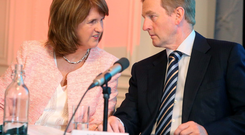 Taoiseach Enda Kenny and Tánaiste Joan Burton. 'Fine Gael adopting a strategically selfish approach to the election date would breach trust and risk collapsing the vote transfer pact agreed between it and the Labour Party'