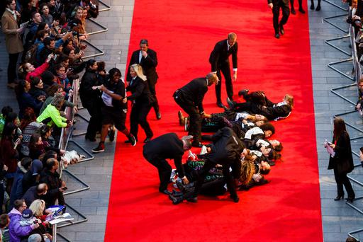 Feminist group Sisters Uncut staged a protest against cuts to domestic violence services at the premiere of Suffragette