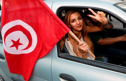 A Tunisian woman celebrates during the Jasmine Revolution of 2011