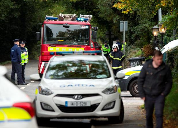 Gardai and fire services at the scene of the tragic fire at Glenamuck Road, Carrickmines, this morning. Photo: Tony Gavin.