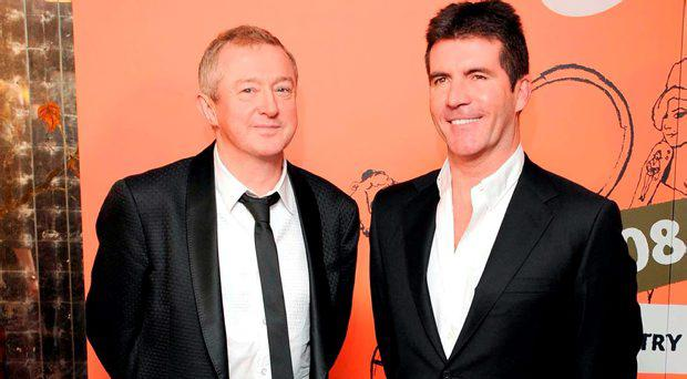 Louis Walsh and Simon Cowell who says his former co-judge on the X Factor is the most popular person in Britain