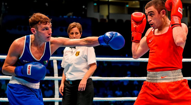 Sean McComb exchanges punches with Albert Selimov, Azerbaijan, during their Men's Lightweight 60kg last 16 bout. Picture credit: Paul Mohan / SPORTSFILE