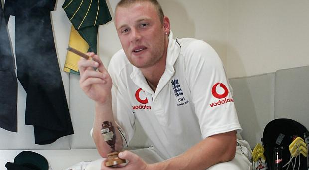 Andrew Flintoff of England celebrates in the changing room following day five of the 2005 Ashes series