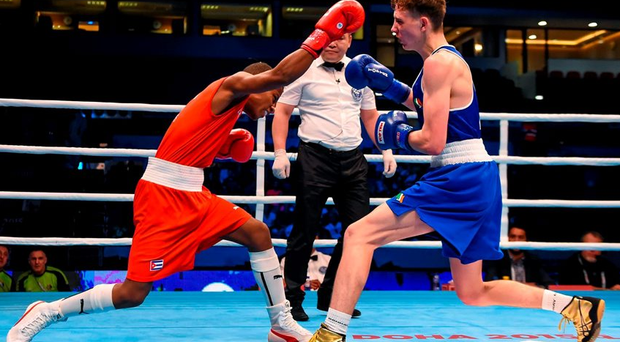 10 October 2015; Brendan Irvine, right, Ireland, exchanges punches with Joahnys Argilagos, Cuba, during their Men's Light Flyweight 46-49kg Quarter-Final bout. AIBA World Boxing Championships, Quarter-Finals, Ali Bin Hamad Al Attiyah Arena, Doha, Qatar. Picture credit: Paul Mohan / SPORTSFILE