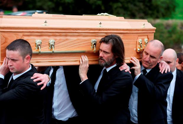 Jim Carrey carries the coffin of ex-girlfriend Cathriona White to Our Lady of Fatima Church, in her home village of Cappawhite, Co Tipperary ahead of her funeral. Niall Carson/PA Wire