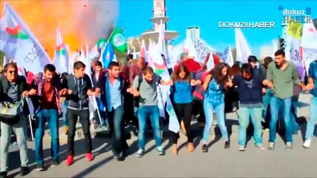 Protesters dance during a peace rally as a blast goes off in Ankara, Turkey October 10, 2015, in this still image taken from a video posted on a social media website. REUTERS/Melike Tombalak/dokuz8HABER via Reuters