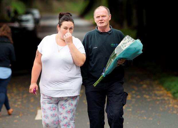 Well wishers brings flowers to the scene of the tragic fire at Glenmaluck Road, Carrickmines, this morning. Photo: Tony Gavin. Photo: Tony Gavin 10/10/2015