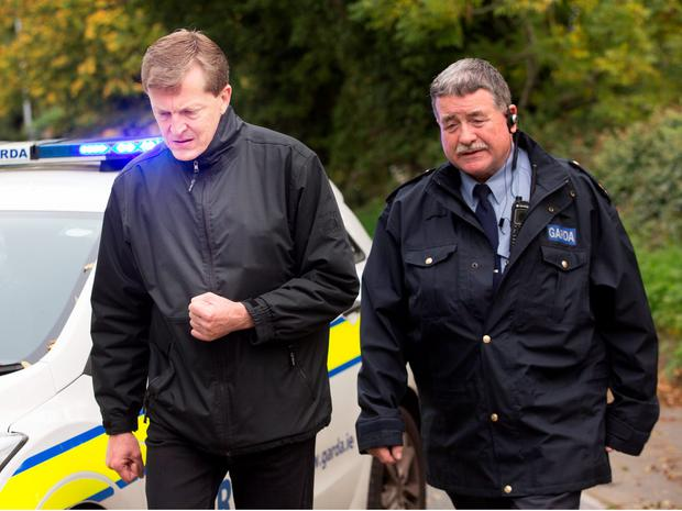 Sandyford Parish Priest Fr. Gerry Moore, left, at the scene of the tragic fire at Glenmaluck Road, Carrickmines. Photo: Tony Gavin.