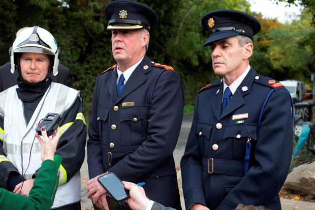 Fire Officer Denis Keely and Garda Superintendent Martin Fitzgerald and Chief Superintendent Diarmuid O'Sullivan at the entrance of the halting site of the tragic fire at Glenmaluck Road, Carrickmines, this morning. Photo: Tony Gavin. Photo: Tony Gavin 10/10/2015
