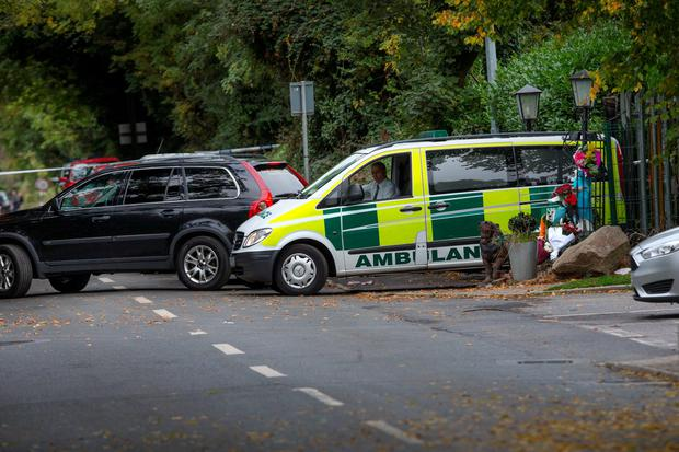 An ambulance containing the bodies of the victims leaves the scene of the tragic fire at Glenmaluck Road, Carrickmines, Photo: Tony Gavin 10/10/2015