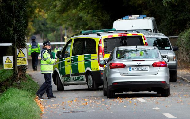 The ambulance hearse leaves the entrance of the halting site of the tragic fire at Glenmaluck Road, Carrickmines where it was bringing away the bodies of the deceased victims. Photo: Tony Gavin.