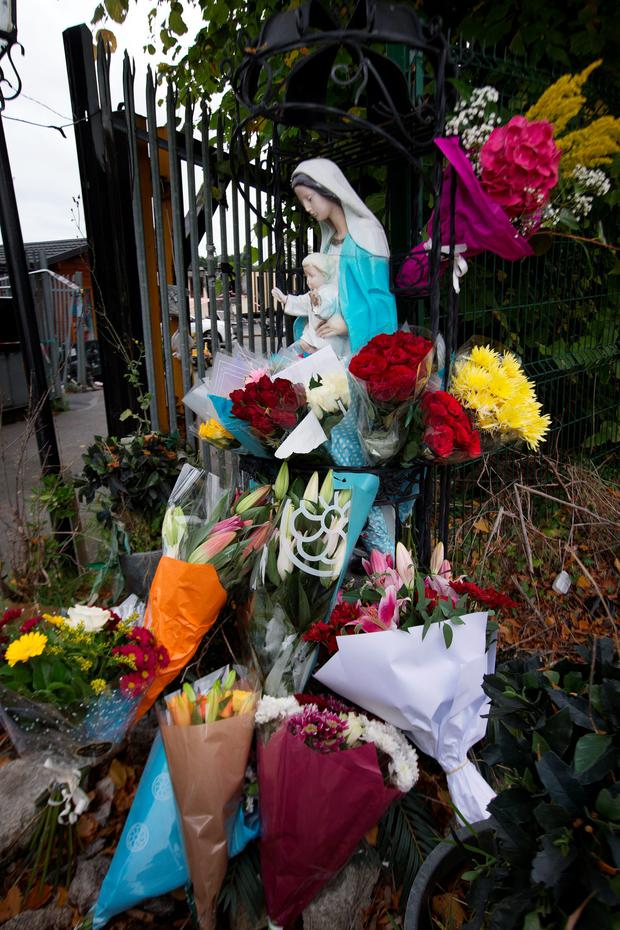 Floral tributes at the scene of the tragic fire at Glenmaluck Road, Carrickmines yesterday. Photo: Tony Gavin. Photo: Tony Gavin 10/10/2015