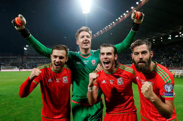 Wales' Aaron Ramsey, Wayne Hennessey, Gareth Bale and Joe Ledley celebrate after qualifying for UEFA Euro 2016 Action Images via Reuters / Matthew Childs Livepic EDITORIAL USE ONLY.
