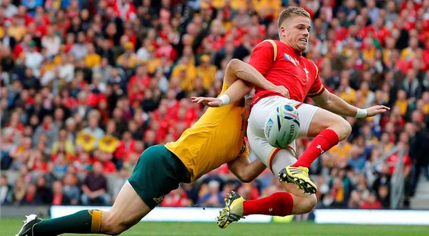 Wales' full-back Gareth Anscombe is tackled by Australia's Drew Mitchell
