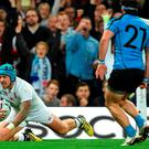 England's wing Jack Nowell scores his third and England's ninth try