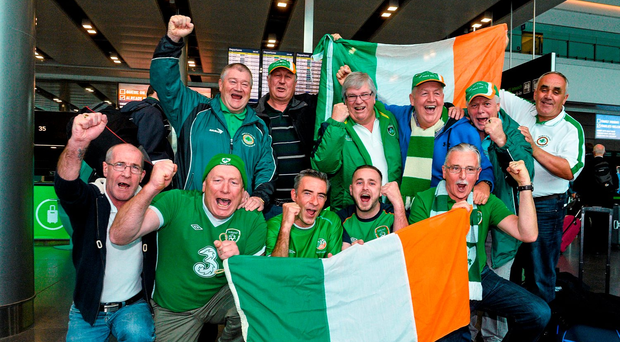 Ireland supporters pose for a photograph before deaprting for Warsaw, Poland, ahead of the Republic of Irealnd's UEFA 2016 Championship, Group D, Qualifier against Poland on Sunday. Republic of Ireland Supporters Depart for Poland. Dublin Airport, Dublin. Picture credit: David Maher / SPORTSFILE