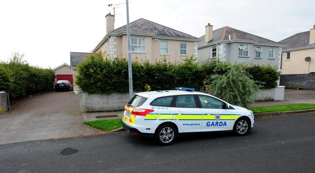 A garda car outside a house in Edgworthstown, Co Longford, where an aggravated burglary took place at at around 1.30am, Sunday morning. Photograph: James Flynn/APX