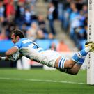 Argentina's Leonardo Senatore scores a try during the Rugby World Cup match at Leicester City Stadium, Leicester.