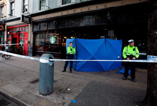11/10/2015 Members of the Gardai at the scene following the discovery of the body of a male on Westmoreland Street, Dublin. Photo: Gareth Chaney Collins