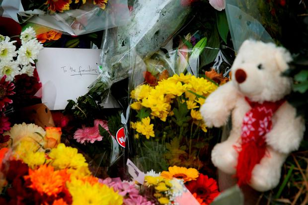 Toys and flowers are left at a halting site for travellers in Carrickmines, south Dublin, where ten people from two families, including a mother, father and a five-month-old baby, were killed in a fire yesterday. Brian Lawless/PA Wire