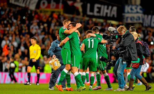 Ireland players Shane Long and David Meyler celebrate their victory over Germany. UEFA EURO 2016 Championship Qualifier, Group D, Republic of Ireland v Germany. Aviva Stadium, Lansdowne Road, Dublin. Picture credit: Matt Browne / SPORTSFILE