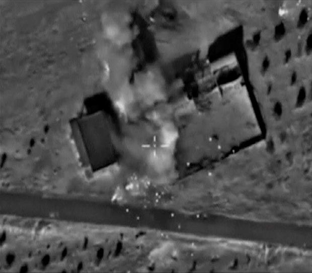A frame grab taken from footage released by Russia's Defence Ministry October 11, 2015, shows what Russia says is smoke rising after air strikes carried out by the Russian air force on locations controlled by Islamic State in Hama province, Syria. REUTERS/Ministry of Defence of the Russian Federation/Handout via Reuters