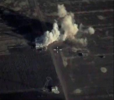 A frame grab taken from footage released by Russia's Defence Ministry October 11, 2015, shows what Russia says is smoke rising after airstrikes carried out by the Russian air force on an Islamic State command post in Latakia province, Syria. REUTERS/Ministry of Defence of the Russian Federation/Handout via Reuters