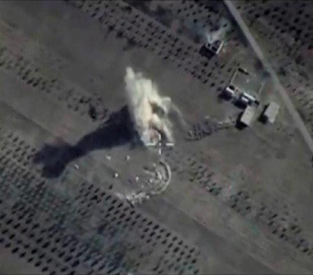 A frame grab taken from footage released by Russia's Defence Ministry October 11, 2015, shows what Russia says is smoke rising after air strikes carried out by the Russian air force on locations controlled by Islamic State in Hama province, Syria. Russian war planes pounded Syrian rebels unaffiliated with Islamic State on Sunday, insurgents said, helping Moscow's ally Bashar al-Assad reclaim territory and dealing a fresh setback to the strategy of Washington and its allies. REUTERS/Ministry of Defence of the Russian Federation/Handout via Reuters ATTENTION EDITORS - THIS IMAGE WAS PROVIDED BY A THIRD PARTY. REUTERS IS UNABLE TO INDEPENDENTLY VERIFY THE AUTHENTICITY, CONTENT, LOCATION OR DATE OF THIS IMAGE. IT IS DISTRIBUTED EXACTLY AS RECEIVED BY REUTERS, AS A SERVICE TO CLIENTS. FOR EDITORIAL USE ONLY. NOT FOR SALE FOR MARKETING OR ADVERTISING CAMPAIGNS. NO SALES.